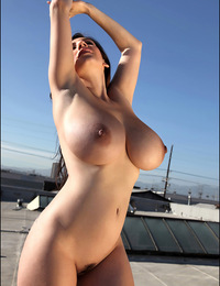 September naked on the rooftop shows huge boobies