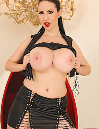 Busty Karina Heart posing in latex and playing with dildo