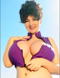 Sarah Nicola Randall poses in a festive red bra