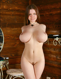 Hot busty pretty Maggie undressing and posing sexy