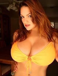 Monica Mendez in tangerine gown