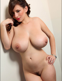 Busty brunette shows her huge fronts and sexy body