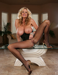 Kelly in black lingerie tears open her fishnets and rubs on her clit with silver vibrator.