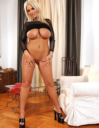 Busty Ines Cudna shows off her shaved pussy and big tits